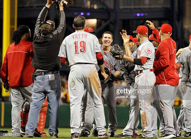 Homer Bailey of the Cincinnati Reds celebrates his nohitter with teammates against the Pittsburgh Pirates during the game on September 28 2012 at PNC...