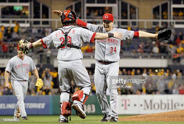 Homer Bailey of the Cincinnati Reds celebrates his nohitter with Ryan Hanigan against the Pittsburgh Pirates during the game on September 28 2012 at...