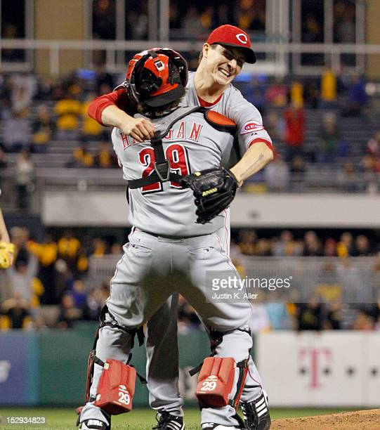 Homer Bailey of the Cincinnati Reds celebrates his no-hitter with Ryan Hanigan against the Pittsburgh Pirates during the game on September 28, 2012...