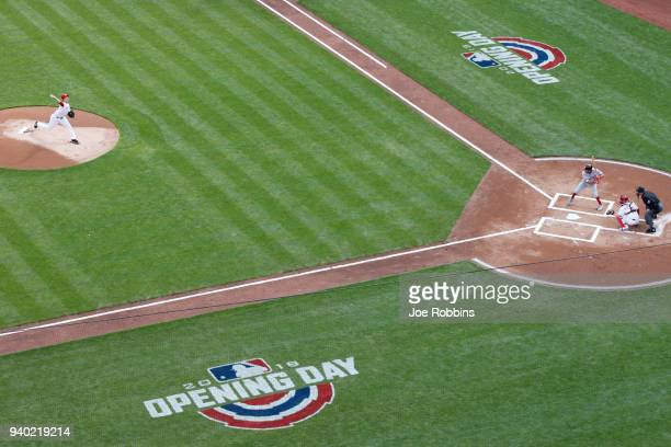 Homer Bailey of the Cincinnati Reds delivers the first pitch of the Opening Day game to Adam Eaton of the Washington Nationals at Great American Ball...