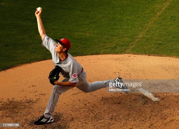 Homer Bailey of the Cincinnati Reds pitches during game one of a doubleheader against the Florida Marlins at Sun Life Stadium on August 24 2011 in...