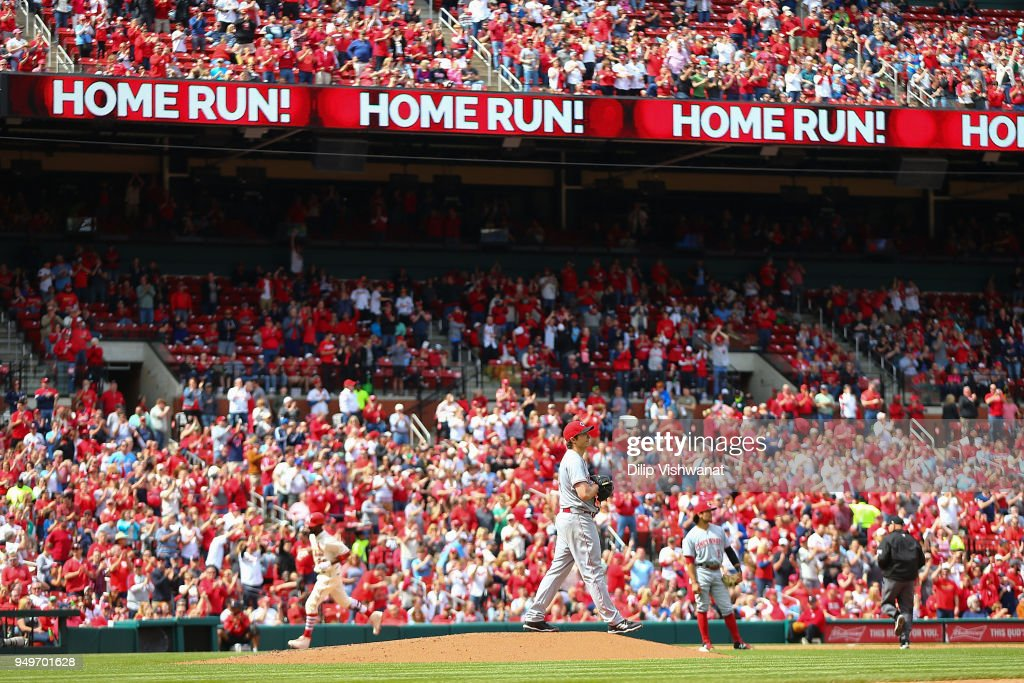 Homer Bailey #34 of the Cincinnati Reds reacts after giving up a home run against the St. Louis Cardinals in the sixth inning at Busch Stadium on April 21, 2018 in St. Louis, Missouri.