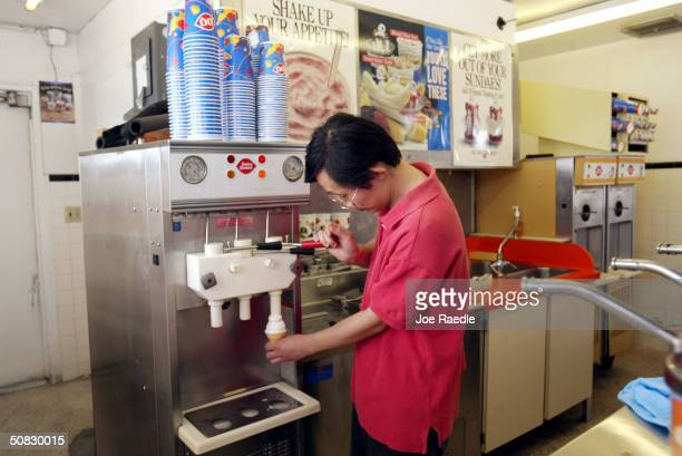 Homer Lee serves a ice cream cone May 12 2004 at Dairy Queen in Miami Florida A combination of political unrest and natural disasters overseas and...