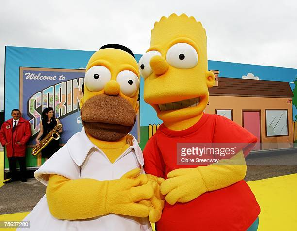 'Homer Simpson' and 'Bart Simpson' pose on the yellow carpet at the UK premiere of The Simpsons Movie at The O2 Greenwich on July 25 2007 in London...