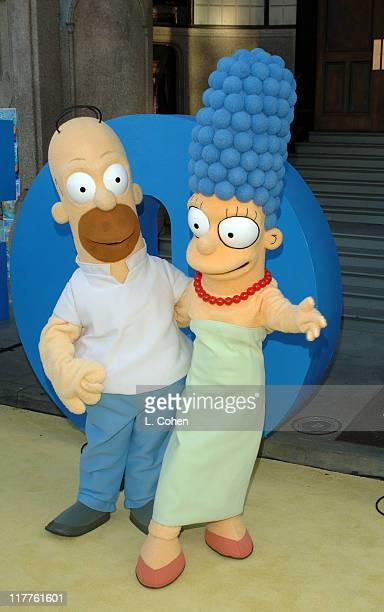 Homer Simpson and Marge Simpson during The Simpsons 350th Episode Block Party at 20th Century Fox Lot in Los Angeles California United States