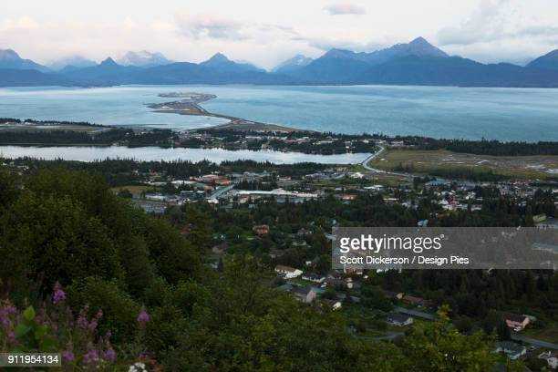 homer spit, kachemak bay and the kenai mountains under a cloudy sky - kachemak bay stock pictures, royalty-free photos & images