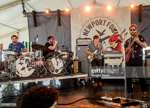 Homer Steinweiss Richard Swift Nick Movshon Leon Michaels and Dan Auerback of Arcs performs during the Newport Folk Festival at Fort Adams State Park...