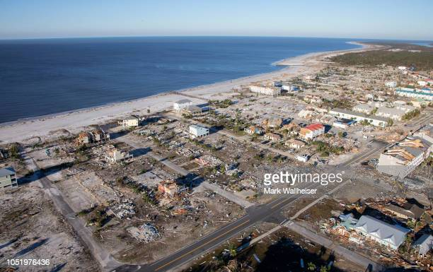 Homes and businesses along US 98 are left in devastation by Hurricane Michael on October 12 2018 in Mexico Beach Florida At least 13 people have been...