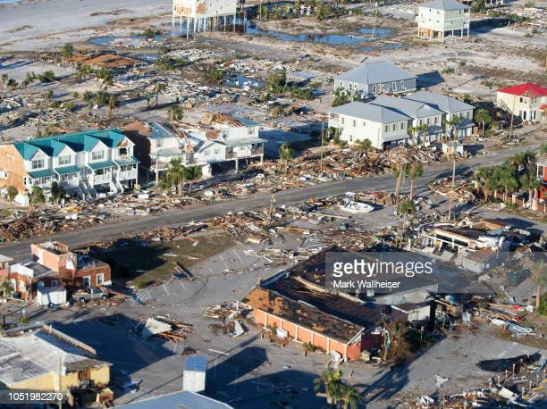 Homes and businesses along US 98 are left in devastation by Hurricane Michael on October 12 2018 in Mexico Beach Florida At least 13 people have died...