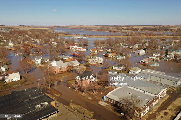 Homes and businesses are surrounded by floodwater on March 20 2019 in Hamburg Iowa Several Midwest states are battling some of the worst flooding...