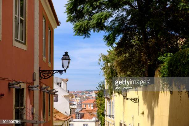 homes and streets of alfama in daytime - alfama stock photos and pictures