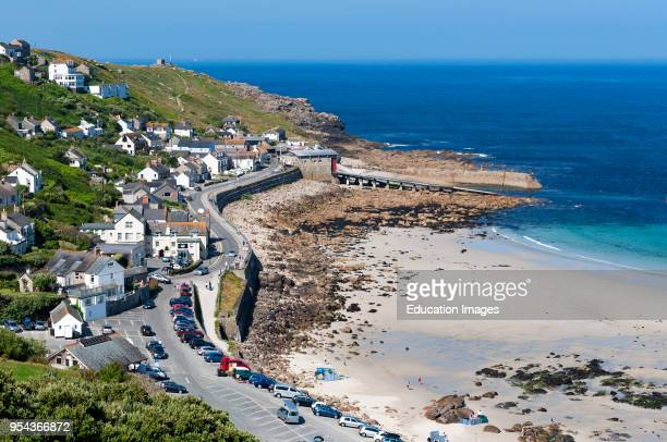 homes and village overlooking the harbor at sennen cove in Cornwall England Britain uk