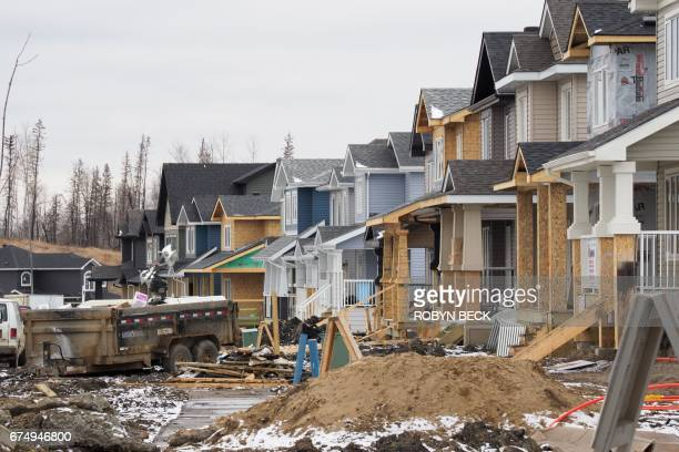 Homes are being rebuilt in Fort McMurray one year after a devastating fire April 18 2017 in Fort McMurray Canada A few lateseason snowflakes flutter...