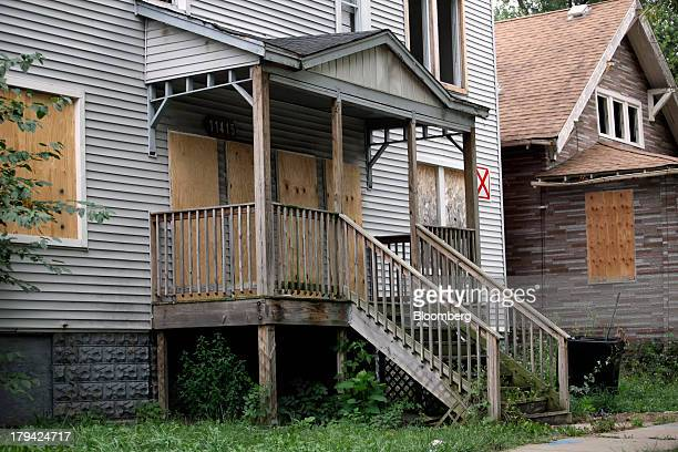 Homes are boardedup with plywood in the Roseland neighborhood of Chicago Illinois US on Wednesday Aug 28 2013 Almost one in 10 Roseland properties is...