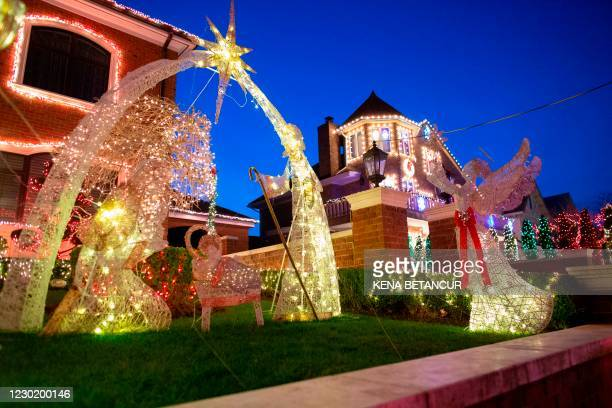 Homes are decorated for Christmas in the Brooklyn neighborhood of Dyker Heights on December 15 in New York City. - In a New York where traditional...