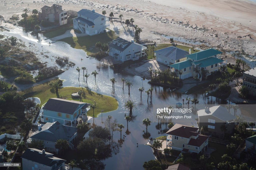 Homes are left surrounded by flood water in the aftermath of Hurricane Irma in St. Augustine, Fla. on Tuesday, Sept 12, 2017.