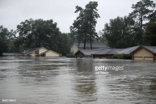 Homes are seen inundated with flooding from Hurricane Harvey on August 28 2017 in Houston Texas Harvey which made landfall north of Corpus Christi...