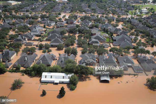 Homes are surrounded by floodwater after torrential rains pounded Southeast Texas following Hurricane and Tropical Storm Harvey on August 31 2017 in...
