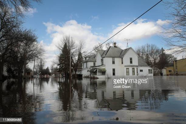 Homes are surrounded by floodwater from the Pecatonica River on March 18 2019 in Freeport Illinois Several Midwest states are battling some of the...