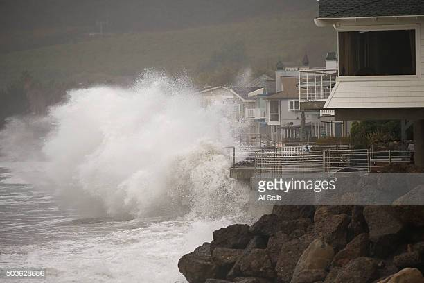 Homes at Mondo's Beach between the Solimar and Faria Beach communities west of Ventura have their sea walls tested Wednesday morning January 06 as...