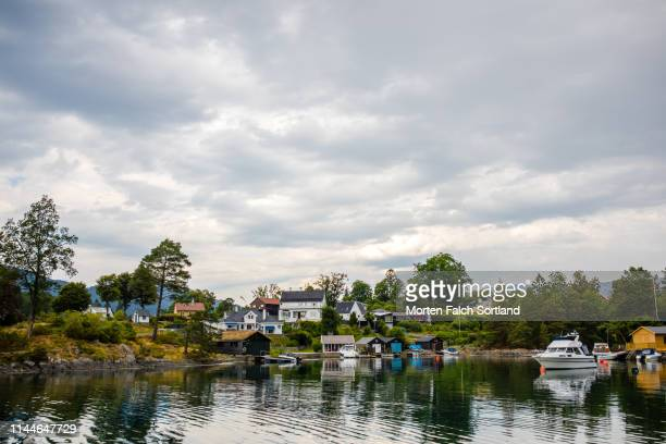 homes by the waterfront in bergen, norway - bergen norway stock pictures, royalty-free photos & images