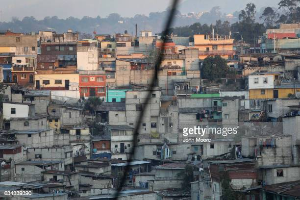 Homes climb up the hillside in the Limonada slum on February 8 2017 in Guatemala City Guatemala Grinding poverty and high crime continue to drive...