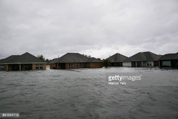Homes completely engulfed in floodwater in the wake of Tropical Storm Harvey in Port Arthur Texas on Aug 30 2017