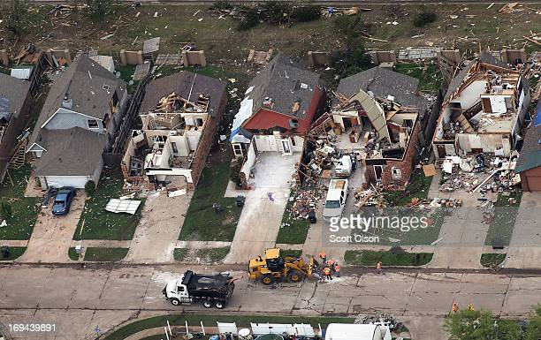 Homes damaged and destroyed by a tornado line a street on May 24 2013 in Moore Oklahoma A twomile wide EF5 tornado touched down in Moore May 20...