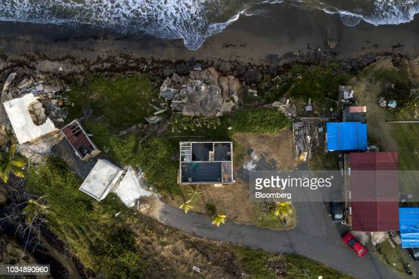 Homes damaged by Hurricane Maria are seen in an aerial photograph taken over El Negro, Yabucoa, Puerto Rico, on Monday, Sept. 17, 2018. A year ago...