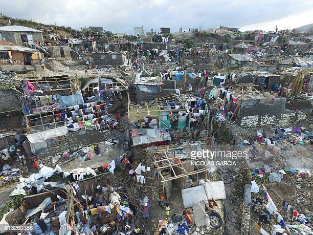 Homes destroyed and damaged by Hurricane Matthew are seen in Jeremie in western Haiti on October 7 2016 The full scale of the devastation in...