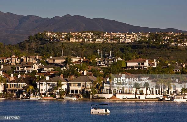 Homes dot the shoreline of Lake Mission Viejo as viewed on January 5 2013 in Mission Viejo California The coastal communities of Laguna Beach Dana...
