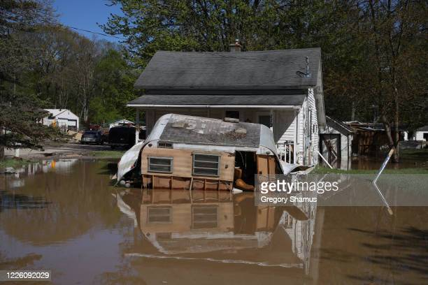 Homes flooded after water from the Tittabawassee River breached a nearby dam on May 20, 2020 in Sanford, Michigan. Thousands of residents have been...
