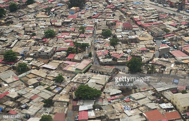 Homes in a poor neighborhood in Luanda Angola are seen from an airplane on May 4 2014 AFP PHOTO / POOL / Saul LOEB