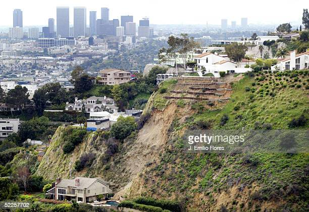 Homes in the Hollywood Hills are threatened by landslide brought on by record rainfall February 28 2005 in Los Angeles California At least three...