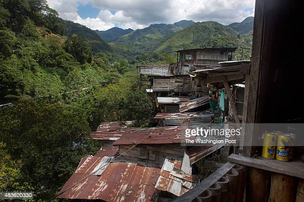 Homes of miners are pictured just outside the Minería Texas Colombia plant in the municipality of Muzo department of Boyacá in Colombia on July 24...