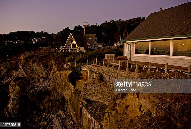 Homes perched on crumbling cliffs overlook the Pacific Ocean at sunset on September 8 near Mendocino California Located a few hours north of San...
