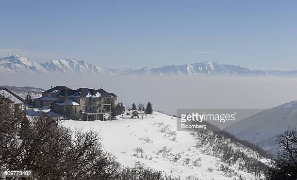 Homes sit above a smogfilled Salt Lake Valley caused by a winter temperature inversion in Draper Utah US on Wednesday Feb 10 2016 With warmer air...