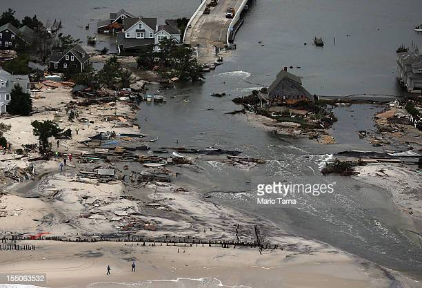 Homes sit in ruin at the end of a bridge wrecked by flooding from Hurricane Sandy on October 31 2012 in Mantoloking New Jersey At least 50 people...