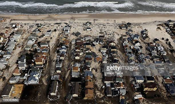 Homes sit in ruin next to the Atlantic Ocean after being destroyed by Hurricane Sandy on October 31 2012 in Seaside Heights New Jersey At least 50...