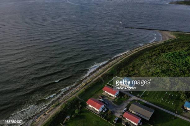 Homes sit next to the Gulf of Mexico in Grand Isle, the only inhabited barrier island in Louisiana on August 24, 2019 in Grand Isle, Louisiana....