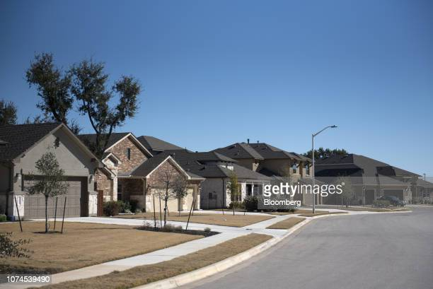 Homes stand in Cedar Park Texas US on Thursday Dec 20 2018 Apple Inc announced this month it's opening new offices in Austin investing $1 billion and...