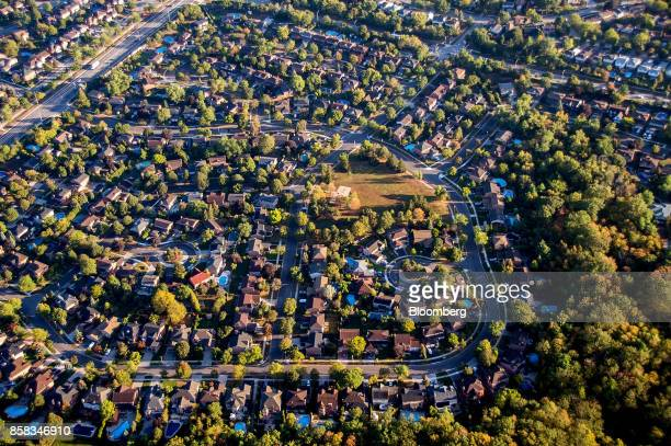 Homes stand in this aerial photograph taken above Toronto Ontario Canada on Monday Oct 2 2017 Toronto housing prices fell for a fourth month in...