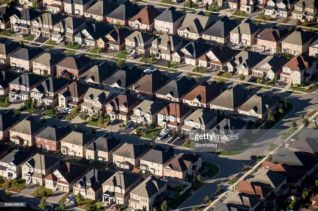 Homes stand in this aerial photograph taken above Toronto, Ontario, Canada, on Monday, Oct. 2, 2017. Toronto housing prices fell for a fourth month in September as sales remained sluggish, particularly in the detached-home segment that has borne the brunt of the correction in Canada's biggest city. Photographer: James MacDonald/Bloomberg via Getty Images