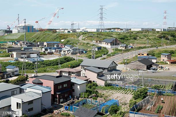 Homes stand near the Electric Power Development Co's Oma nuclear power plant which is under construction in Oma Town Aomori Prefecture Japan on...