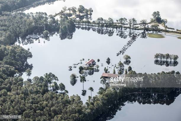 Homes surrounded by floodwater are seen in this aerial photograph taken above New Bern North Carolina US on Friday Sept 21 2018 Record floods cover...