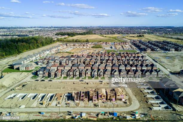 Homes under construction are seen in this aerial photograph taken above Brampton Ontario Canada on Saturday Sept 9 2017 Toronto home builders are...