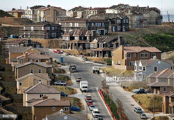 Homes under construction stand in the background of completed homes in the San Diego California Serramar Ranch development on Tuesday December 20...