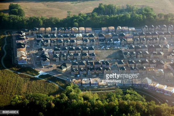 Homes under construction stand in this aerial photograph taken above Toronto Ontario Canada on Monday Oct 2 2017 Toronto housing prices fell for a...