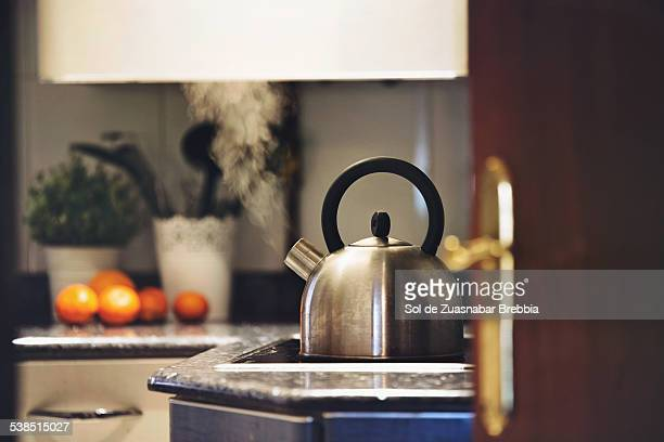 Home's warmth. Steam coming out of a kettle
