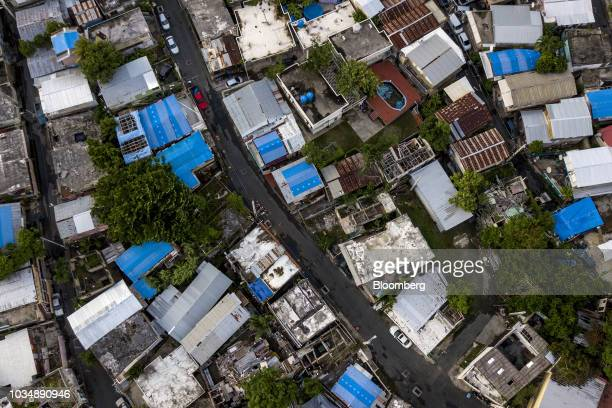 Homes with Federal Emergency Management Agency /US Army Corps of Engineers blue roof temporary tarps are seen in an aerial photograph taken over San...